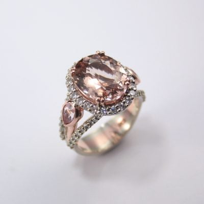 9ct White and Rose Gold Ring, featuring a 5.27ct Oval Cut Peach Morganite, plus two Pear Cut Morganites 0.40ct each and 58x Round Brilliant Cut G/SI Diamonds totalling 1.00ct  Reference Code: LJ-R372